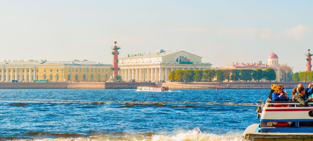 St Petersburg panorama-Neva river and Saint Petersburg landmarks of Vasilievsky island with touristic boats in St Petersburg