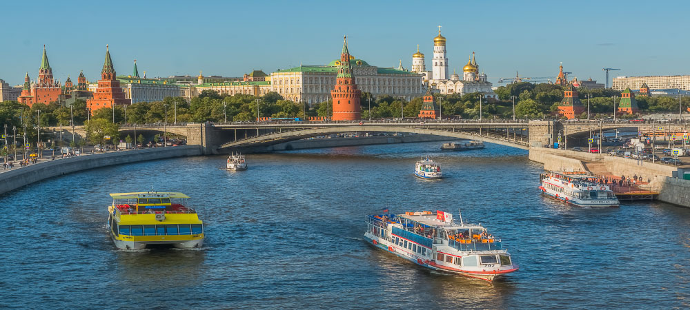 The Kremlin Moscow river boats and embankment
